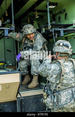 New York Army National Guard Spc. Muhammad Alam, a  medic assigned to Co. B., 1st Battalion, 69th Infantry, New - Stock Photo