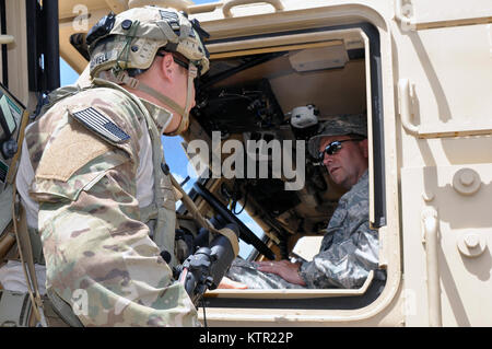 Massachusetts Army National Guard Staff Sgt. William Farwell (left), an Operations Non-commissioned officer assigned - Stock Photo