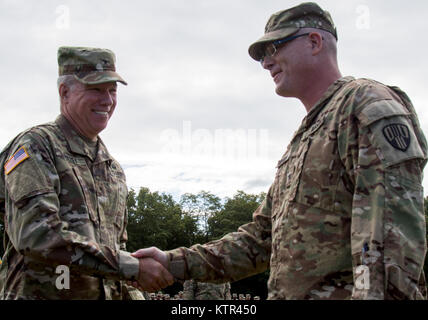 U.S. Army Brig. Gen. Michael Swezey, the commander of New York Army National Guard's 53d Troop Command, shakes hands - Stock Photo