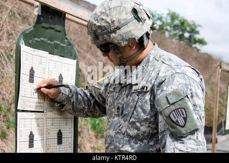 U.S. Army Staff Sgt. James Kim, a quartermaster and chemical equipment repairer assigned to the New York Army National - Stock Photo