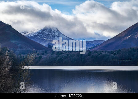 Newlands Valley across Derwentwater with Robinson covered in snow - Stock Photo