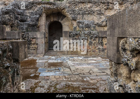 Roman amphitheater in Italica (north of modern day Santiponce, 9 km NW of Seville, Spain) is a magnificent and well - Stock Photo