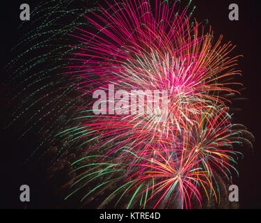 Fireworks bursting in the air on Independence Day - Stock Photo