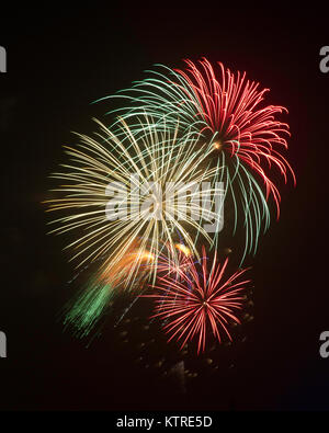 Fireworks bursting in the night sky on Independence Day (Fourth of July) - Stock Photo