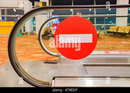 Close up no entry sign on airport travelator - Stock Photo