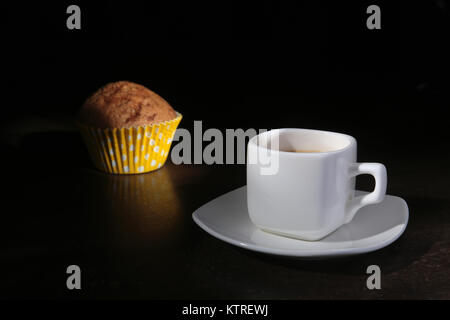 Homemade muffin with raisins and cup classic espresso coffee. selective focus. - Stock Photo