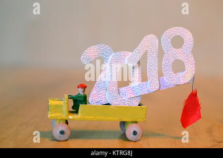 Number 2018 on old wooden toy car. A truck with a big new year number. - Stock Photo