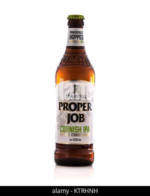 SWINDON, UK - DECEMBER 27, 2017: Bottle of St Austell Brewery Proper Job Cornish IPA Beer - Stock Photo