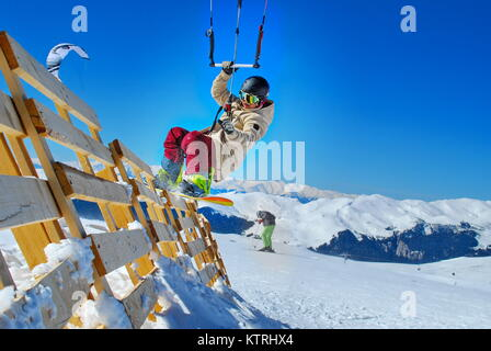 athlete snowboarder doing snowkiting on the snow in the mountain - Stock Photo