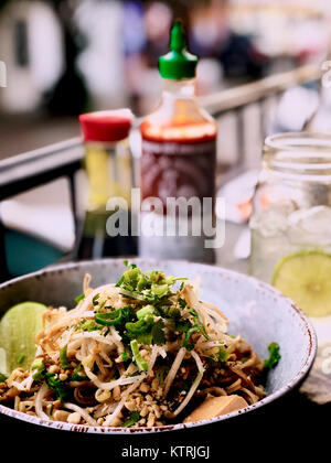 Pad Thai - Asian street food fried noodle dish from Thailand - Stock Photo