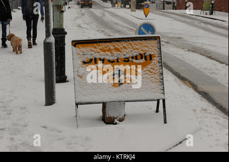 A diversion road sign covered in snow on Muswell Hill Road in London on December 10 2017 - Stock Photo