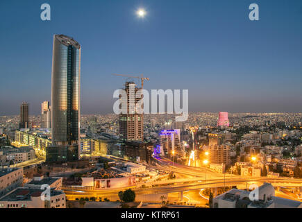 Top view of the new downtown of Amman at night with moon - Stock Photo
