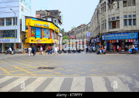 Cars and motorcycles waiting for traffic signal at Laxmi road Pune, Maharashtra - Stock Photo
