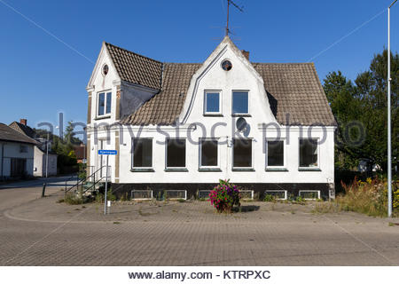 Vacant house in small village; Thorshoej, Vendsyssel, Denmark - Stock Photo