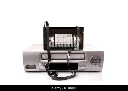 Old VHS Video recorder with tape on a white background with copy space - Stock Photo