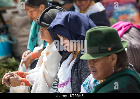 Otavalo, Ecuador-December 23, 2017: closeup of indigenous women wearing tradition clothing - Stock Photo