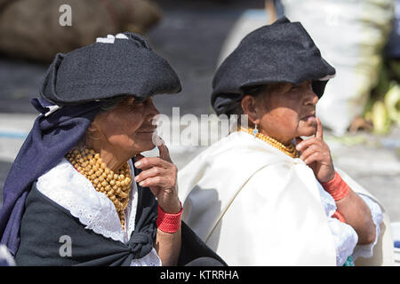Otavalo, Ecuador-December 23, 2017: indigenous quechua women wearing traditional clothing in the Saturday market - Stock Photo