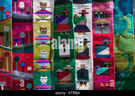 Otavalo, Ecuador-December 23, 2017: indigenous textiles in the Saturdaay artisan market - Stock Photo