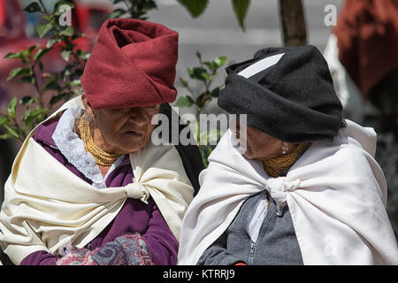 Otavalo, Ecuador-December 23, 2017: idigenous women talking to each-other outdoors - Stock Photo