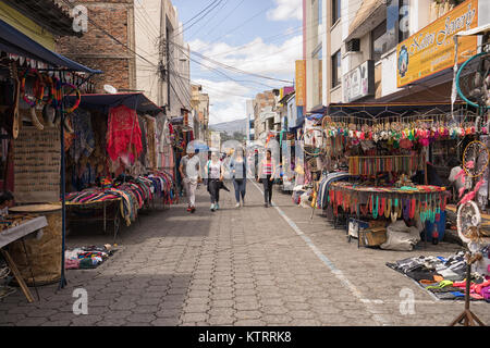 Otavalo, Ecuador-December 23, 2017: vendor stands set up on the street of the indigenous town on the traditional - Stock Photo