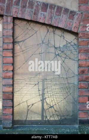 Broken window in old factory building - Stock Photo