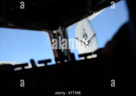 A boom lowers from a KC-135R Stratotanker, assigned to the 141st Air Refueling Squadron, 108th Wing, New Jersey - Stock Photo