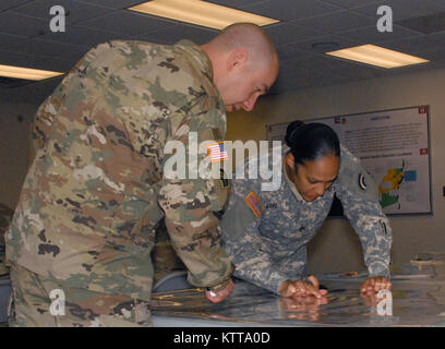 Sgt. 1st Class Michael Giarrusso, a 42nd Infantry Division operations NCO (left), and Staff Sgt. Diahann Adepegba, - Stock Photo