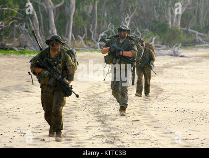 SHOALWATER BAY, Queensland, Australia – Soldiers from Charlie Troop, 2nd Battalion, 101st Cavalry Squadron, patrol - Stock Photo