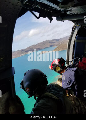 Aircrew survey the destruction from the helicopter over the U.S. Virgin Islands.  Airmen from the New York Air National - Stock Photo