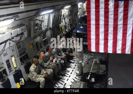 Airmen assigned to the 105th Communications Flight leave on board a C-17 Globemaster III at Stewart Air National - Stock Photo