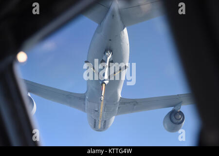 A KC-135 Stratotanker from the 171st Air Refueling Wing prepares to refuel a C-17 Globemaster from the 105th Airlift - Stock Photo