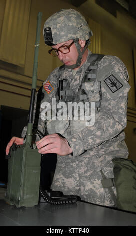 LATHAM, N.Y.-- Sgt 1st Class David Colliton of Joint Force Headquarters, New York National Guard., programs a Single - Stock Photo