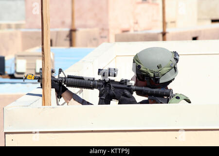 NATIONAL TRAINING CENTER, FORT IRWIN, Calif. – A Soldier from 11th Armored Cavalry Regiment, role-playing as an - Stock Photo