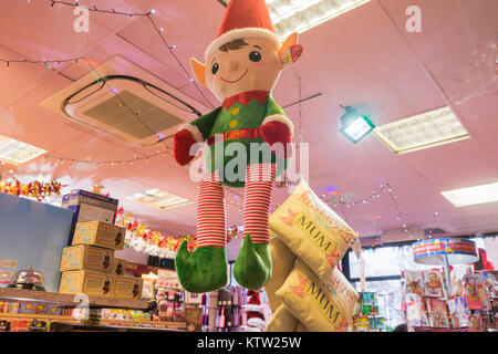 Christmas decorations on display in a shop selling Christmas decorations and presents, England, UK - Stock Photo