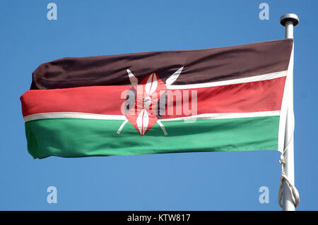 Kenyan flag against blue sky - Stock Photo