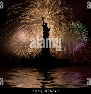 Statue of Liberty on the background of fireworks - Stock Photo