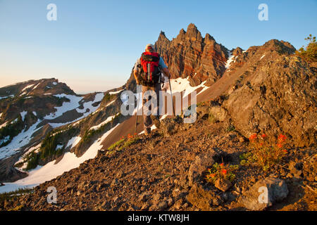 Hiker on the Pacific Crest Trail Near Three Fingered Jack Outside Sisters Oregon - Stock Photo