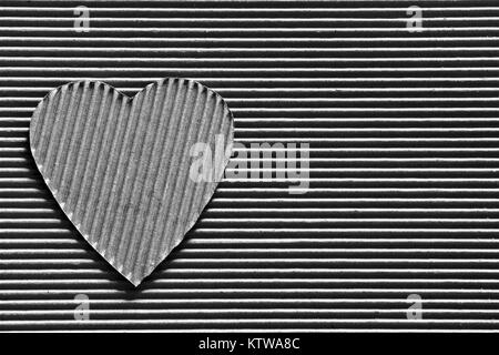 Valentine - heart symbol carved out of corrugated cardboard. Copy space. Free space for text, Close-up, top view. - Stock Photo