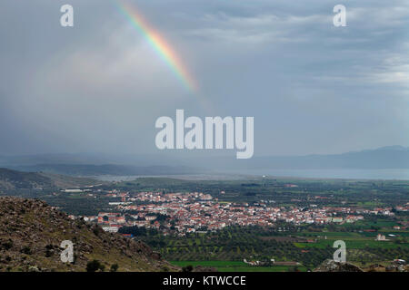 Panoramic view of the village of Kalloni, in Lesvos island, with a rainbow just after the rain. - Stock Photo