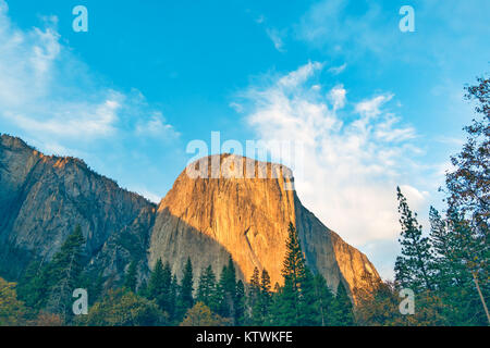 El Capitan close-up with blooming golden sunset light. Yosemite National Park, California. The must-go attraction - Stock Photo