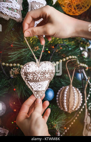 Hipster hands with Christmas sackcloth heart - Stock Photo