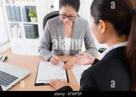 back view photo of female business agent successfully introducing new cooperation case for client and her partner - Stock Photo