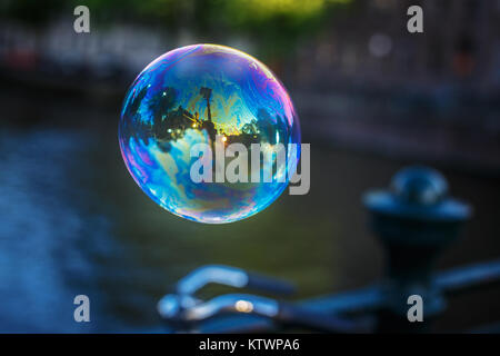 Soap bubble . Somewhere on the stree - Stock Photo