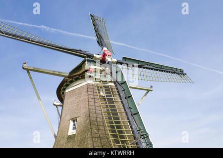 Traditional Dutch windmill De Hoop in Elspeet in Holland. - Stock Photo