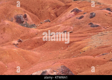 Abandoned red colored land similar to planet Mars' surface - Stock Photo
