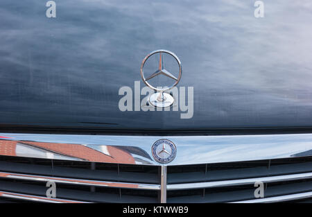 Mercedes Benz logo star on a car. Mercedes-Benz is a German automobile manufacturer. The brand is used for luxury - Stock Photo