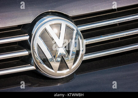 Volkswagen VW plate logo on a car grill. Volkswagen is a famous European car manufacturer company based on Germany - Stock Photo