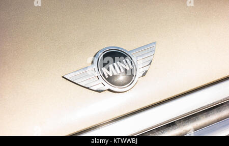 Mini cooper logo on a golden car. It is a model produced by BMW since 2000. BMW is a German luxury vehicle, motorcycle, - Stock Photo