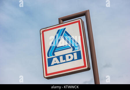 Aldi sign (north division) against blue sky. The German-based discount supermarket chain currently operates over - Stock Photo