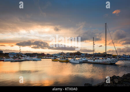 Stykkisholmur harbour at sunset. Stykkisholmur is a town situated in the western part of Iceland, in the northern - Stock Photo
